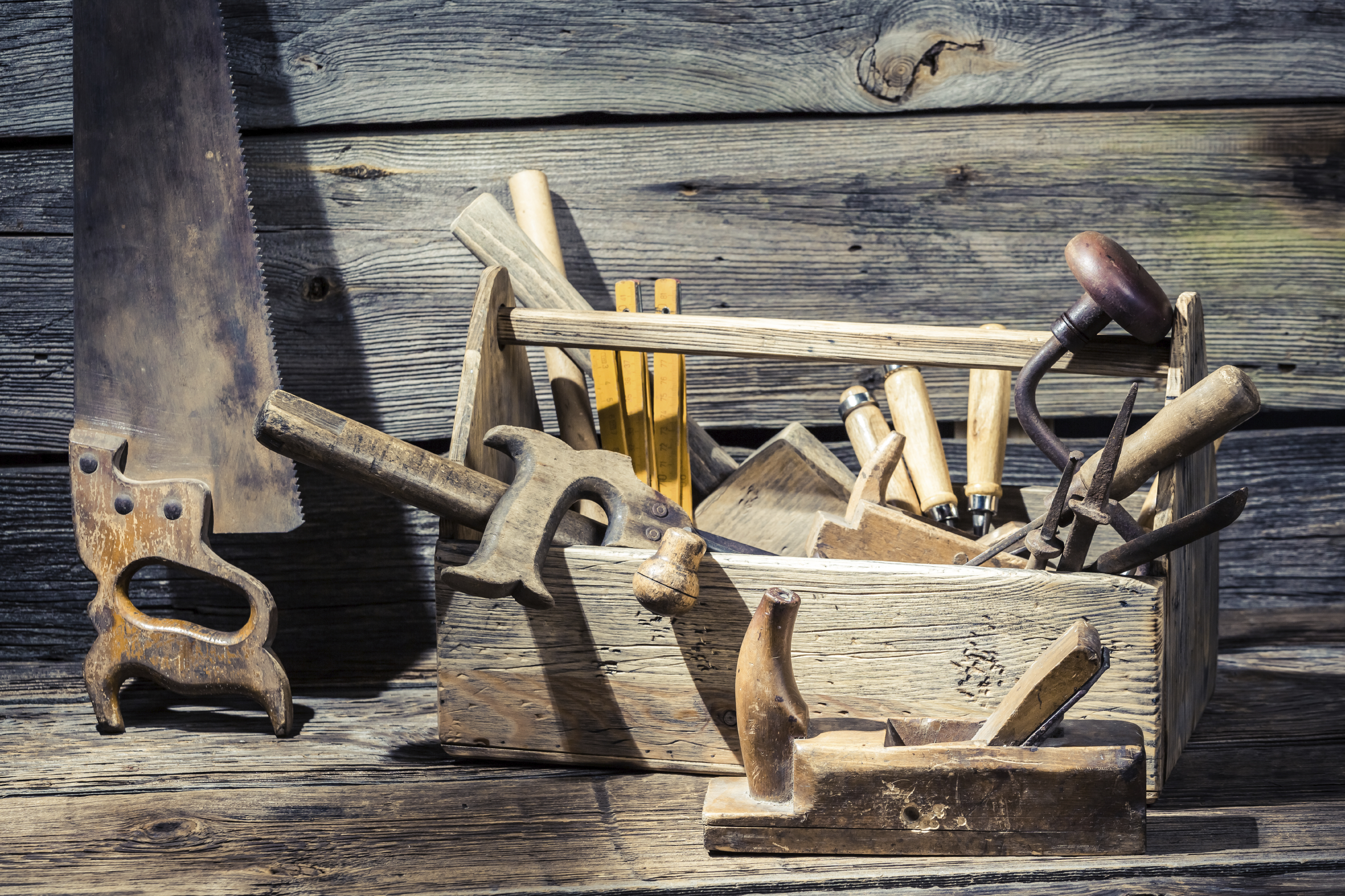Vintage carpenter tools in a wooden box