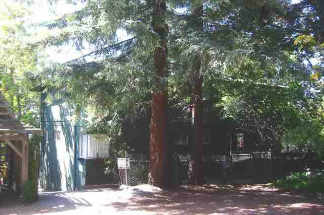 Fireplace in living room and master; laundry facility in unit. Quiet setting yet next to campus and close to all amenities of North Berkeley. Lovely tree setting.  Sold $480,000